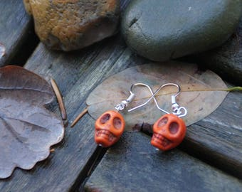 Earrings shaped Orange howlite skulls