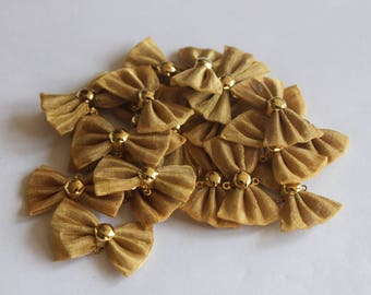 set of 2 bows in brass golden color 23 * 13 mm