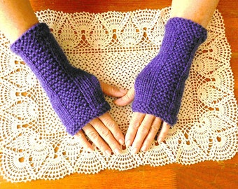 Purple fingerless gloves knitted by hand.