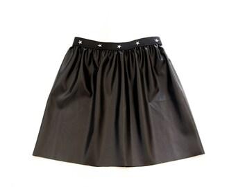 Girl black faux leather skirt