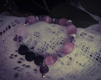 Handcrafted pink bead and lava stone stretch bracelet