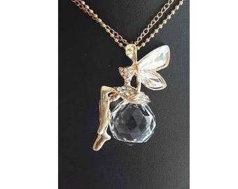 A pretty golden Elf faceted cubic zirconia crystal ball necklace