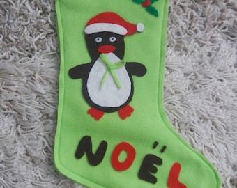 Green Christmas Santa sock for children. Christmas decoration.
