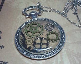 Metal necklace with pendant. Gears and resin. Steampunk