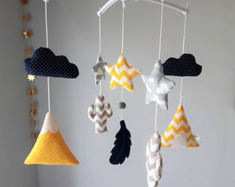 Baby mobile heart clouds, stars in shades of yellow, grey and light blue with musical gallows