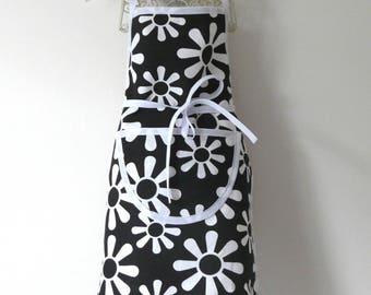 Black apron printed white flowers