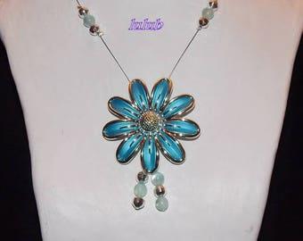 Mid-length necklace with a sky blue daisy style flower
