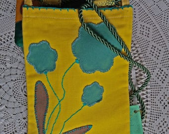 Youth handbag with sides of different shades of yellow; hand embroidered