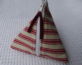 small pouch shaped gift-wrapped in tissue