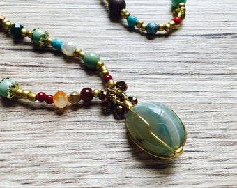 Long necklace with glass beads and natural stones, agate pendant.