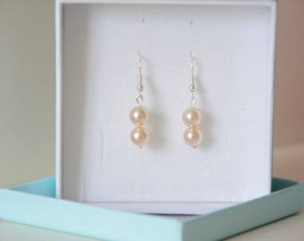 Earrings two ivory white pearls