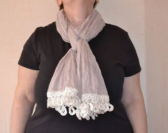 Beige scarf with a crocheted border
