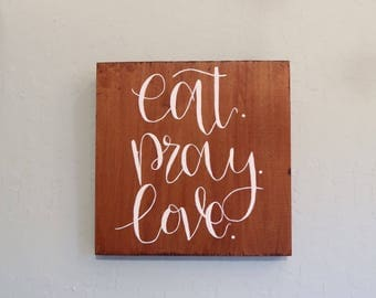 Eat pray love wood sign