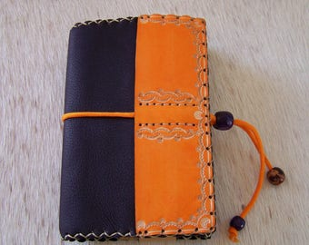 Handcrafted leather plum and orange paperback book cover