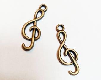 Bronze colored music treble clef charm