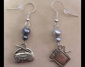 "Mismatched earrings ""television and radio"""