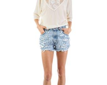 Metamorfus Vintage Denim Levi's Shorts embellished with pearls.