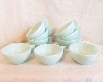 Nine vintage French art deco milk glass coffee cups in pale blue.