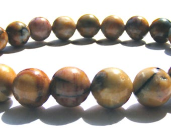 Bracelet jaspe composé de 24 perles de 8 mm jaune et grise et ficelle élactic.