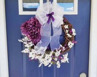 Handmade luxury Spring or Summer wreath with white and purple flowers. Wreath with white sheer bow and purple accent bow. Farmhouse rustic