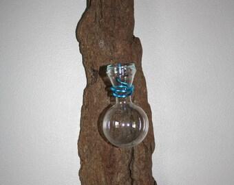 Vase on pine bark, turquoise blue thread