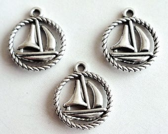 Lot 5 charms boat / yacht in circle rope - silver