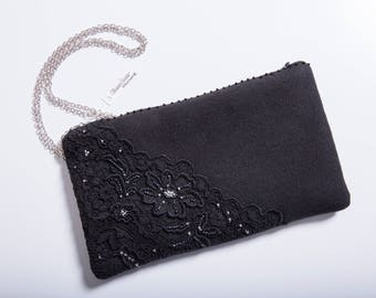 Clutch bag in cloth with embroidered lace and beads