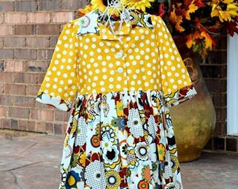 I love to sew.. This sweet dress is perfect for that little girl.