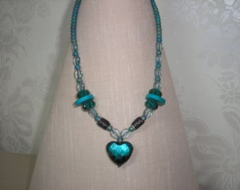 Jade coloured beaded necklace with heart pendant