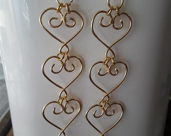Stacked Golden Hearts with Dangling Clear Bead Earrings