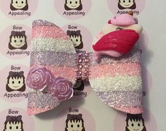 Pink white and lilac stripe unicorn glitter bow for girls, ideal for parties and dress up