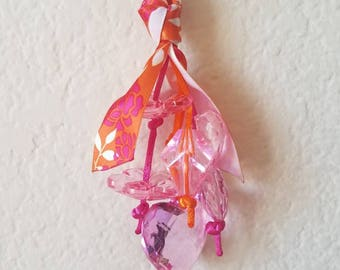 Orange and Pink keychain with a floral ribbon and large beads