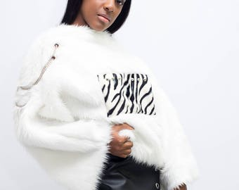 White fluffy sweatshirt with zebra application, chains and rates