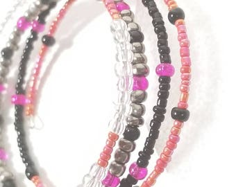 Pink black and silver memory wire bracelet.