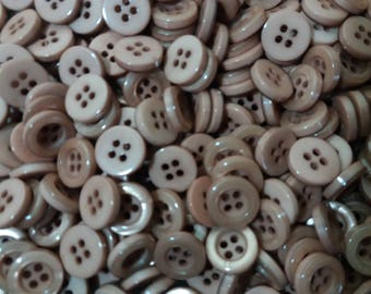 100 brown buttons