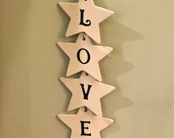 Clay LOVE sign