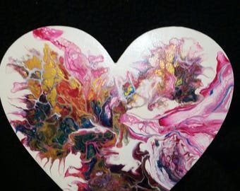 Acrylic fluid pour on wooden heart.