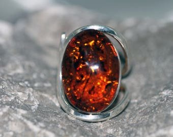 Baltic Amber Ring. Classic cognac piece of Amber fitted in sterling silver. Handmade & unique. Ring is adjustable.