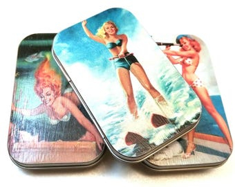 Large tin trio . . . Cheesecake ladies. Great for earrings.