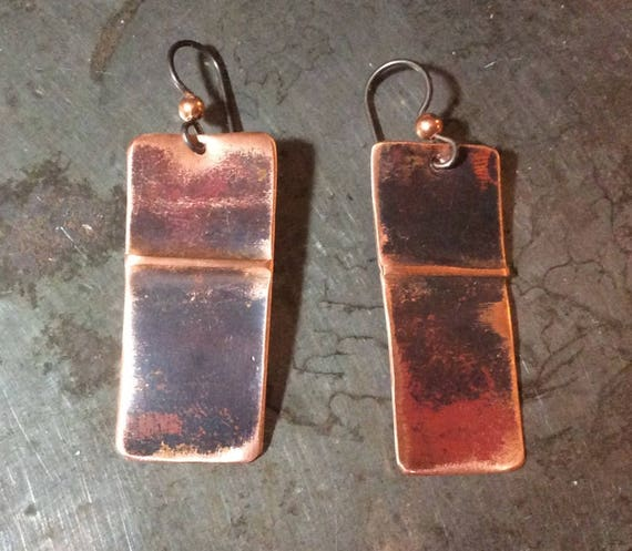 Abstract copper rectangles with a folded line