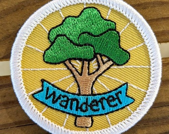 wanderer - round embroidered iron-on patch featuring tree