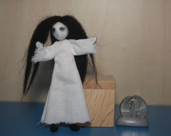 Tiny ghost girl doll