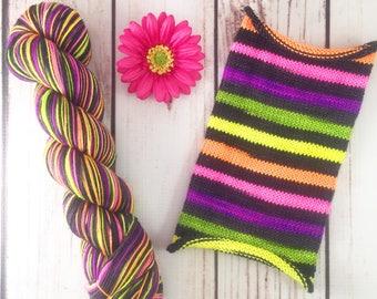 Black-light fluorescent yarn! Zombies On The Half Shell: Hand-dyed gradient self-striping sock yarn, 75/25 SW merino/nylon