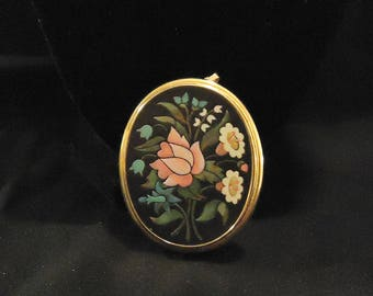 Large Oval Pendant by Avon Black Background Pink White Blue Flower Details Green Leaves Stems Vintage 1970's Statement Costume Jewelry
