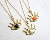 The Beholder - Brass and Onyx / Peach Moonstone /Opal  Blink Necklace - Eye Lashes