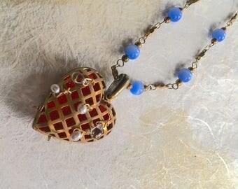 Elizabeth Moderne Locket Necklace