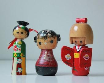 3 Vintage wooden kokeshi dolls