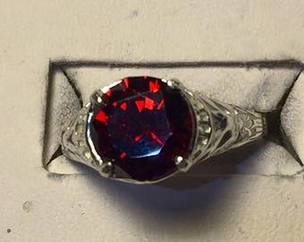 Red zircon silver filigree ring