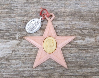 Vintage 1930/1950 French  plastic star with tin medal  /ex voto/ reliquary