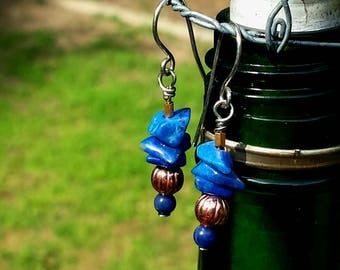 sterling silver earrings made with natural blue lapis lazuli gemstones and copper bead dangles